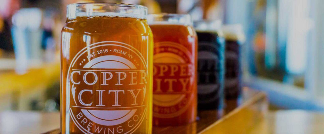 "<img src=""http://coppercitybrewingcompany.townsquareinteractive.com/files/2017/01/coppercity_logo_600_2-300x283.png"" class=""dl-logo"">"